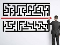 A Horizontal Straight Line Cutting Across A Puzzle Maze Representing Intex Networking's Simplicity of E.T.H.O.S Core Values