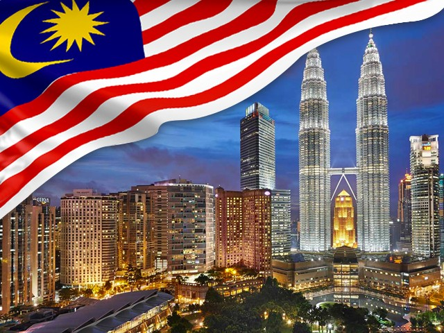 A Waving Malaysian Flag With The Iconic KLCC In Kuala Lumpur Representing Intex Networking As A Malaysian Firm.